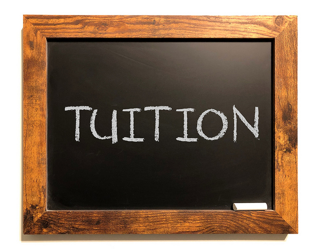 An image of a blackboard with the word tuition