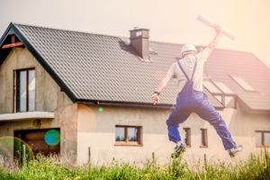 a picture of house with construction worker jumping for joy