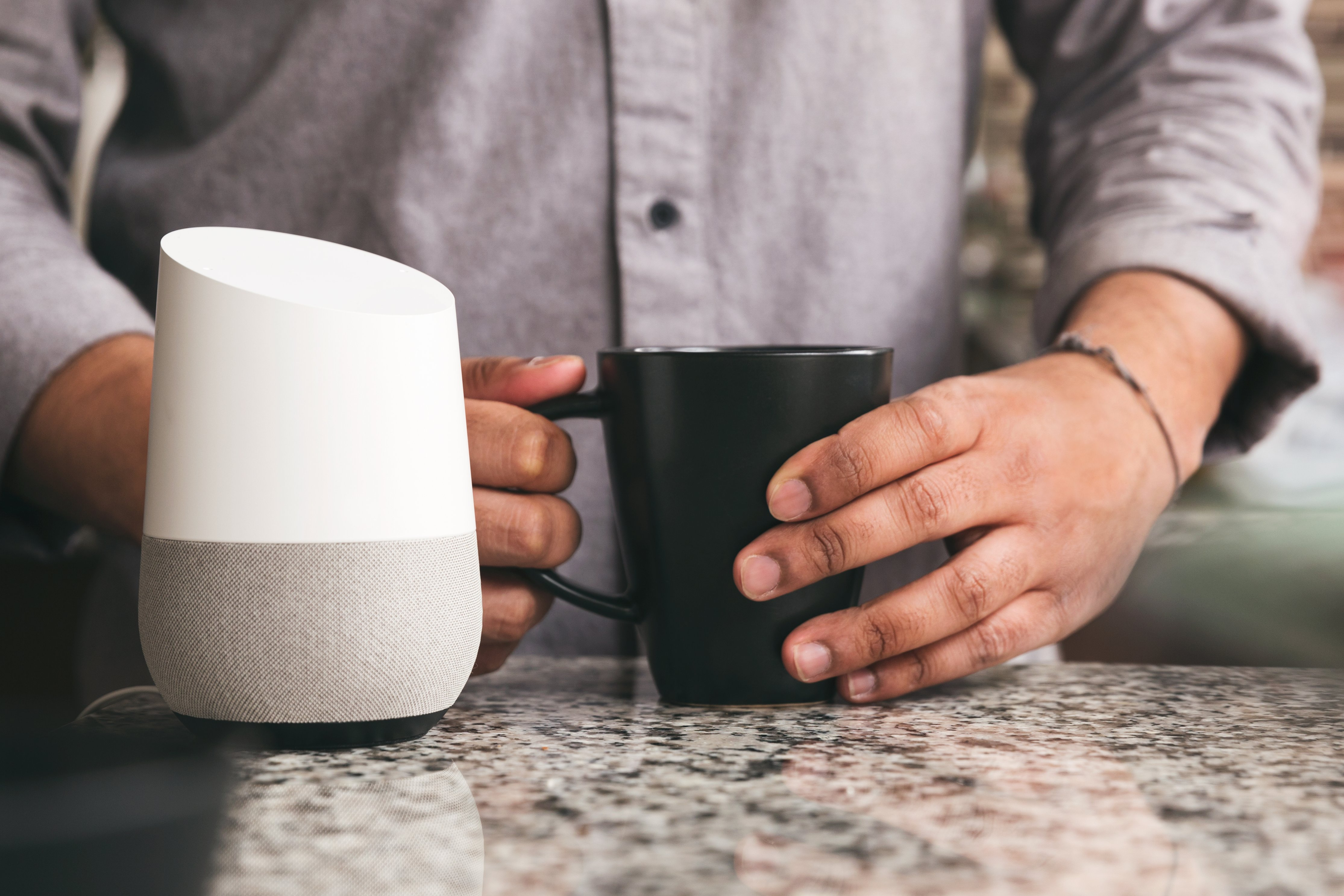 a person using a smart speaker