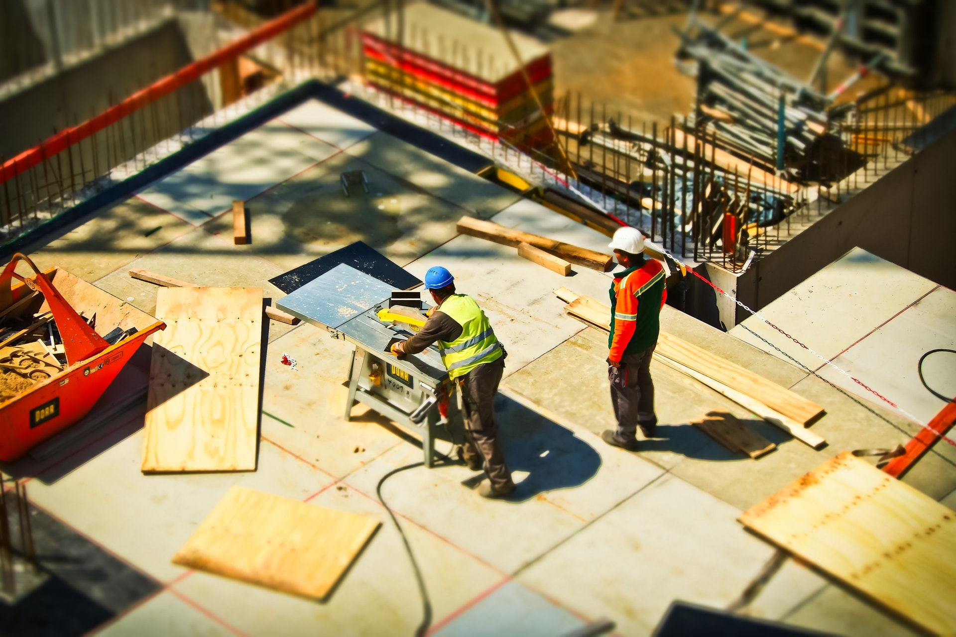 an image of construction manager overseeing staff on construction site.