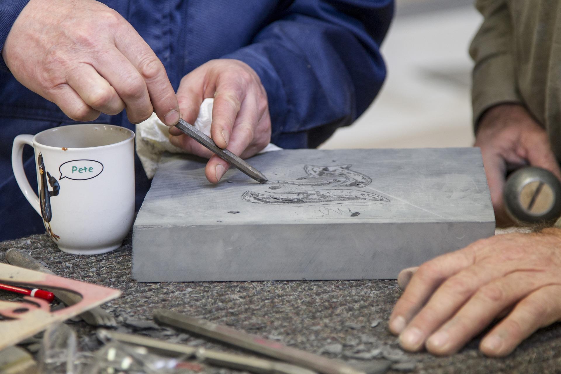 a stonemason teaching a student
