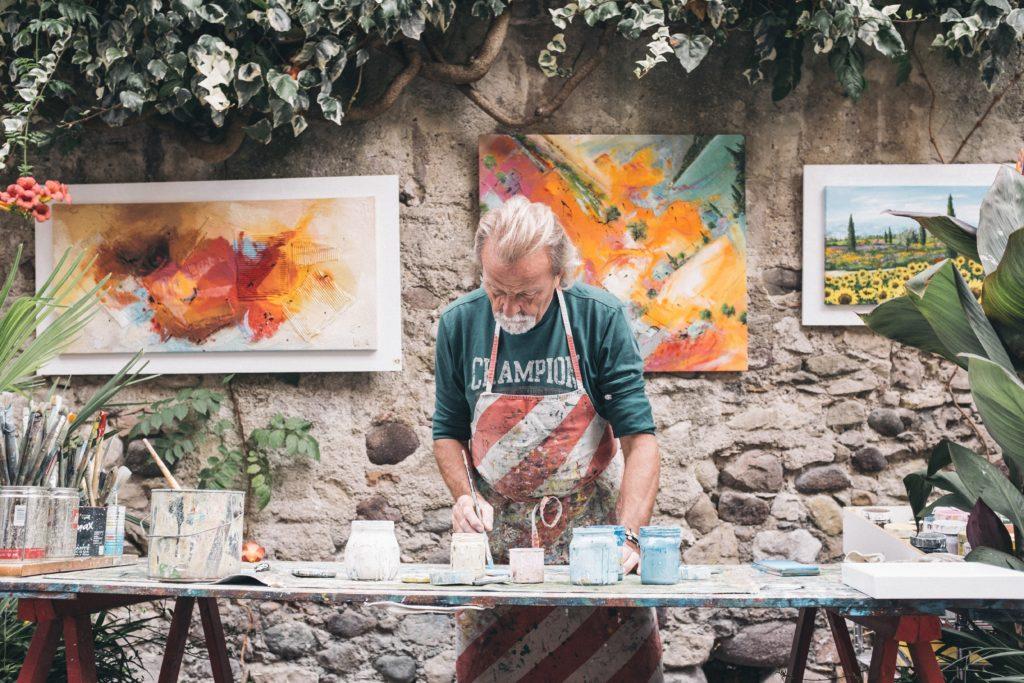 Man painting. Rewarding jobs that aren't behind desks in offices