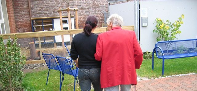 support worker helping elderly lady