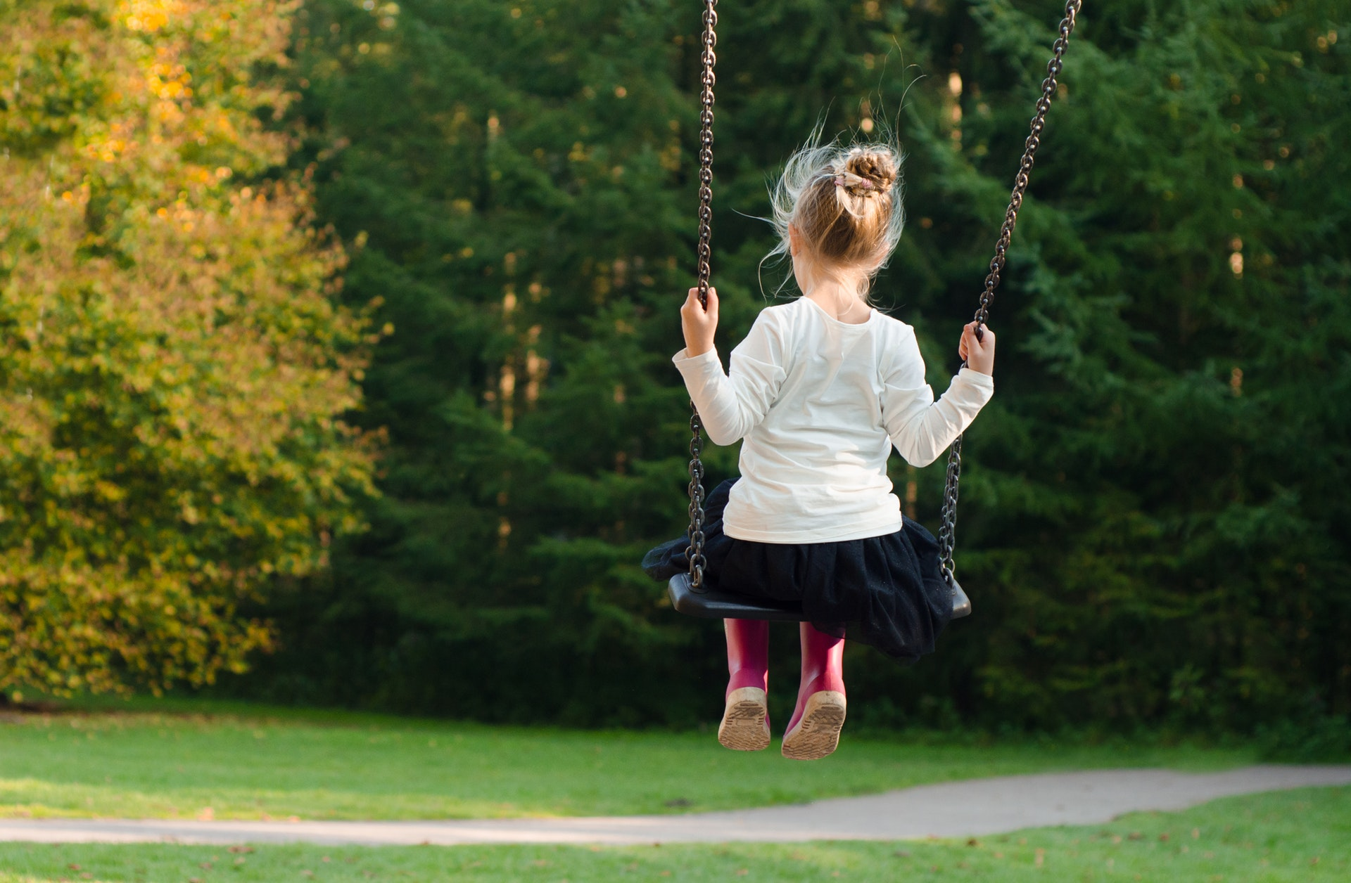 an image of a girl on swing