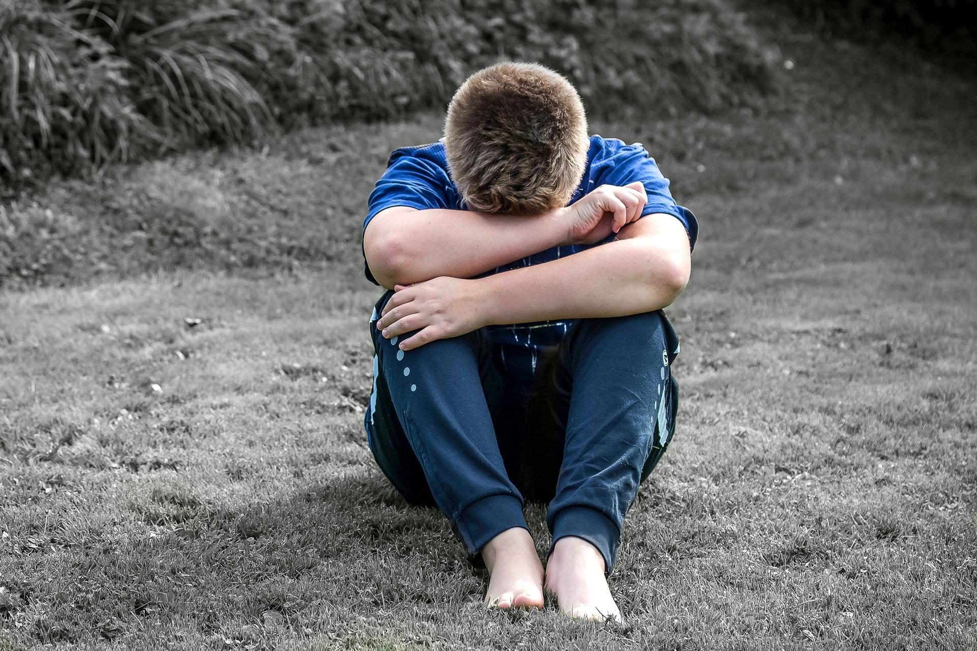an image of depressed boy