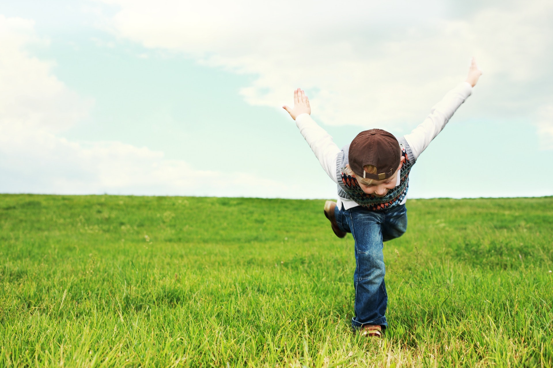 An image of child running in the fields