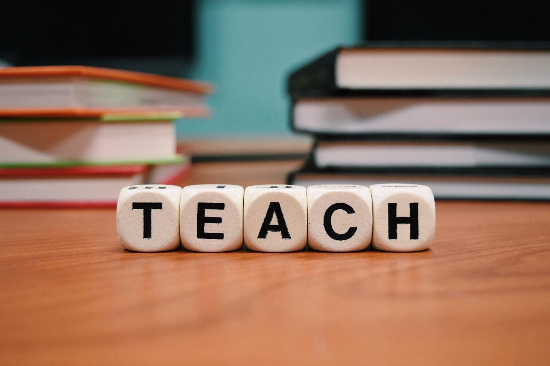 an image with word teach