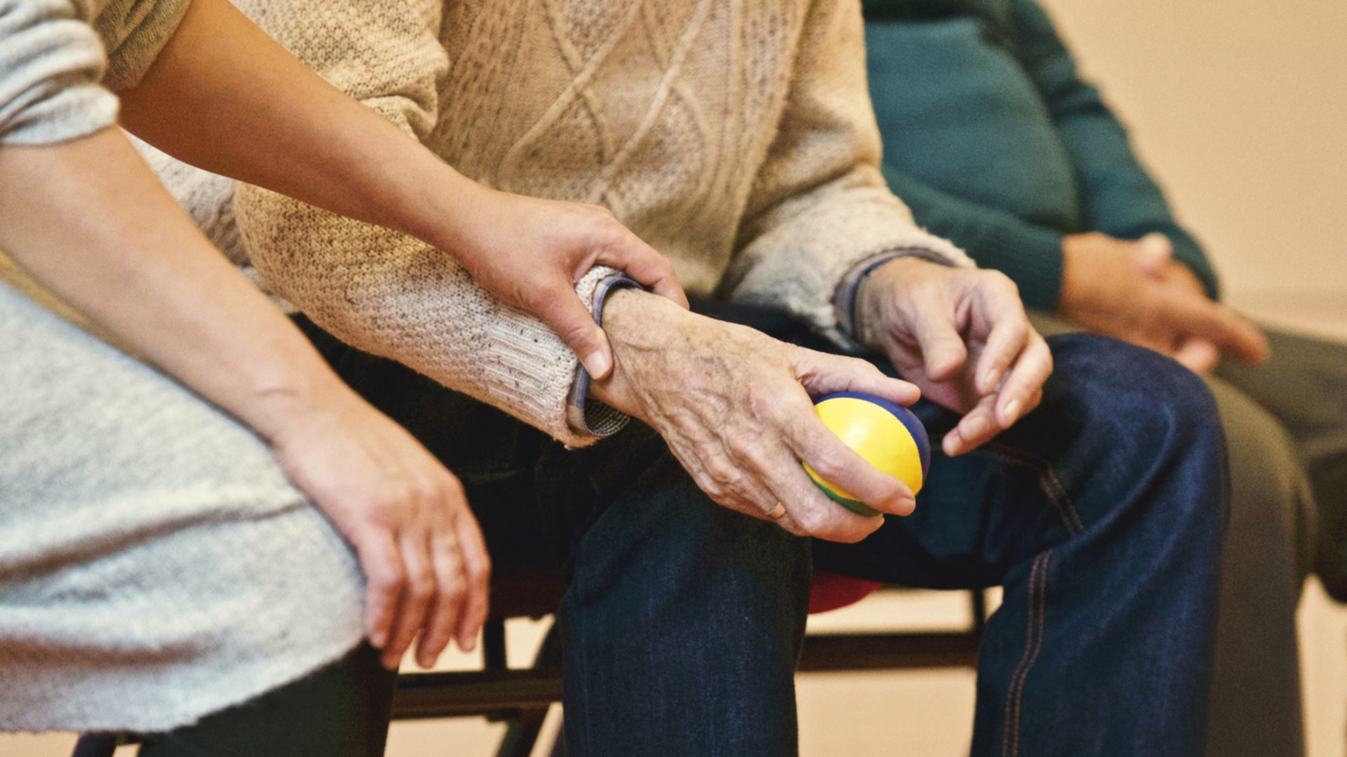 image of care worker helping elderly