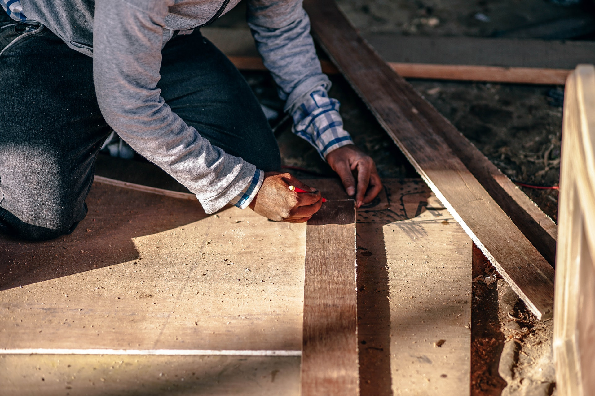 An image showing a carpenter at work