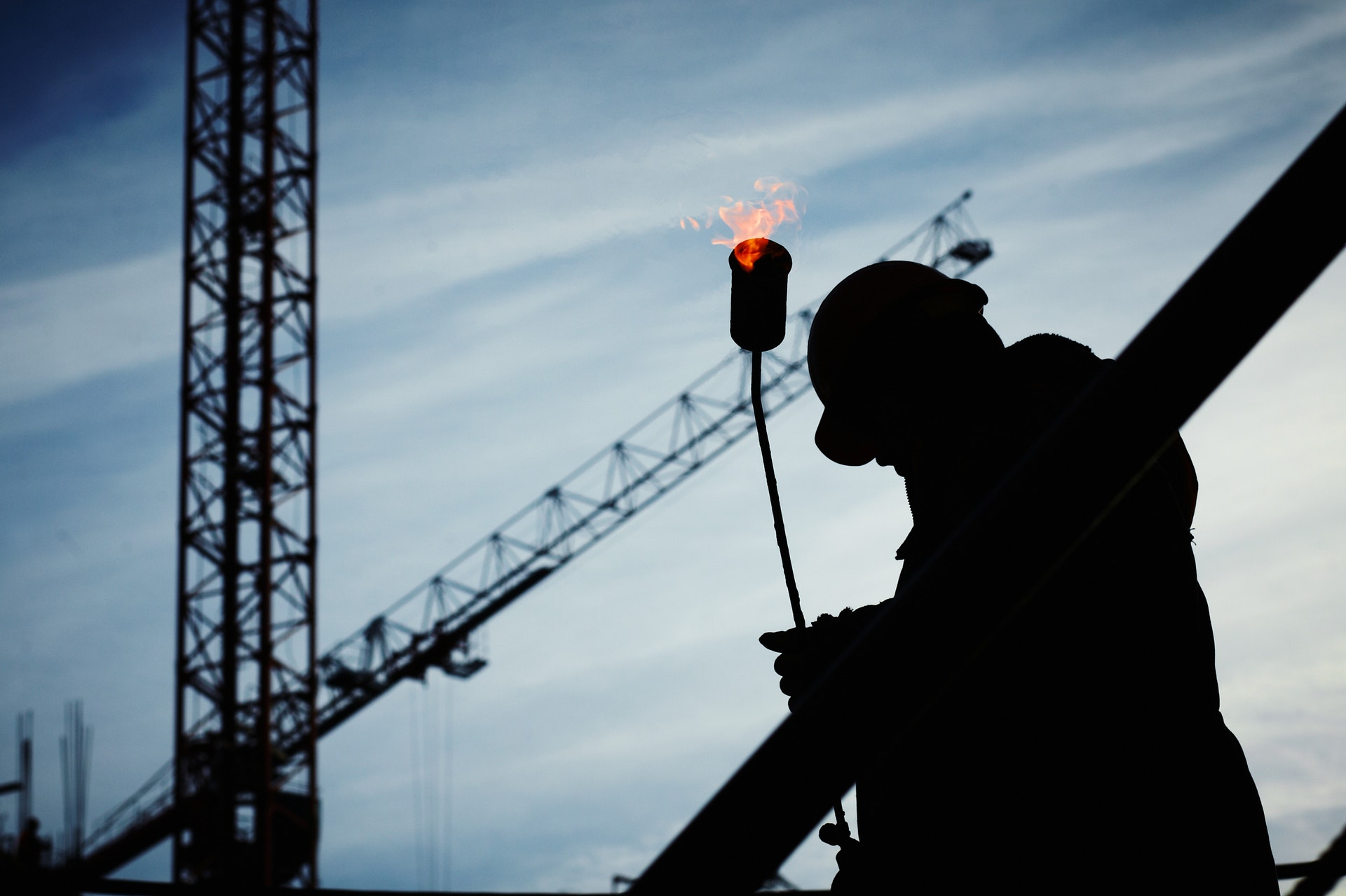 a silhouette picture of a construction worker